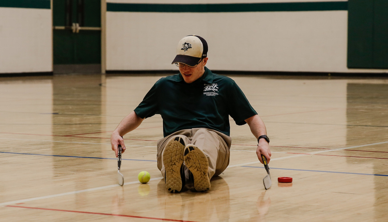 Man playing sled hockey