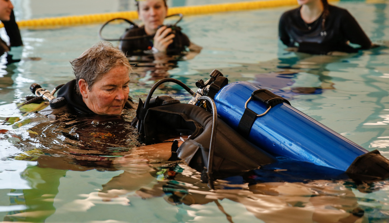 Students learning about scuba diving with accessability issues