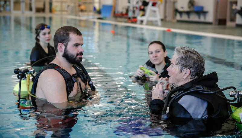 Students learning about scuba diving with a disability