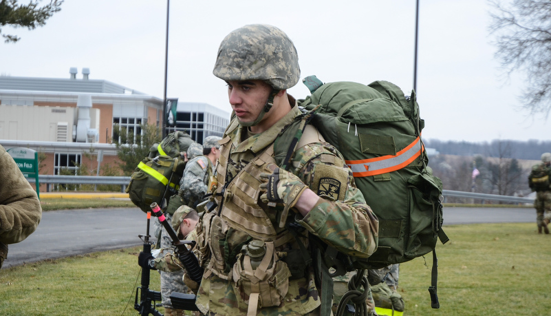 Cadet putting on a ruck sack