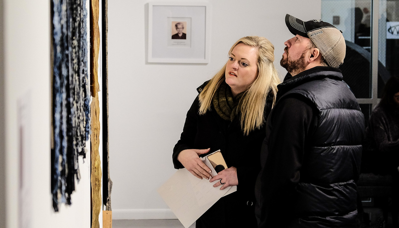 a couple looking at art on display