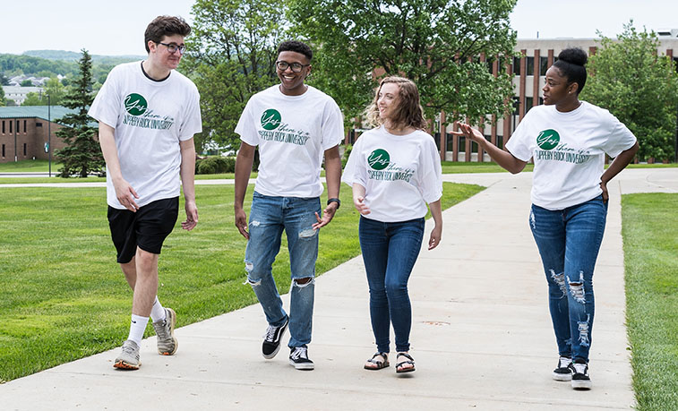 Students walking across capmus wearing the newly released shirts