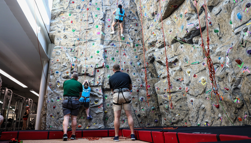 Campers climbing the wall