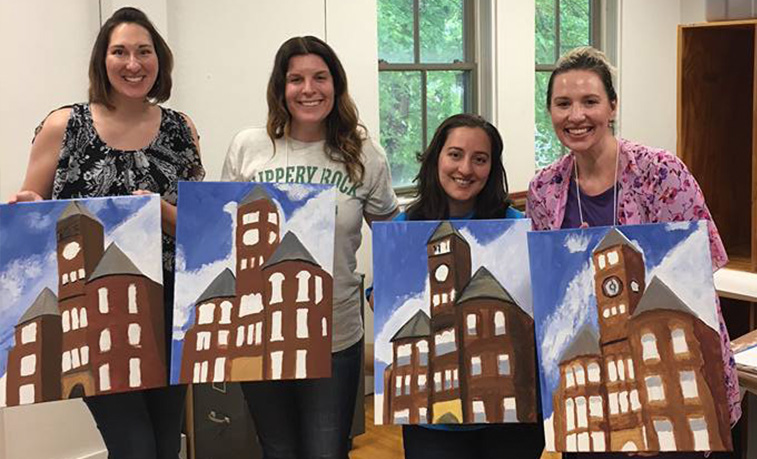 Alumni participating in a painting event at the 2018 Alumni Weekend