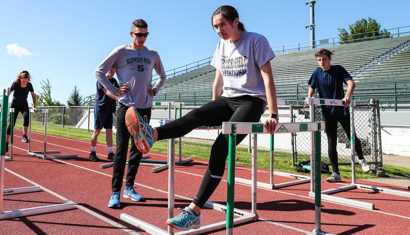 students doing drills for hurdling