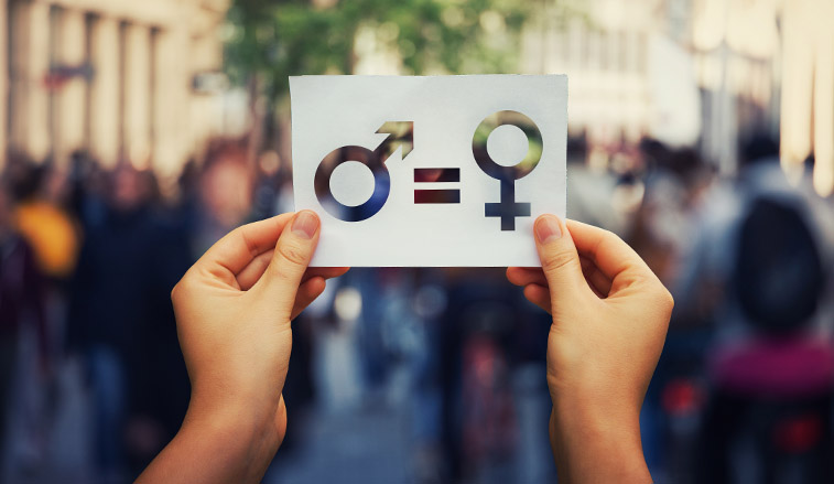 Hands holding a card representing gender equality