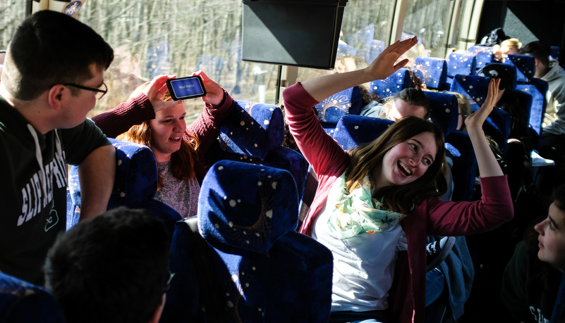 Students play games on the bus