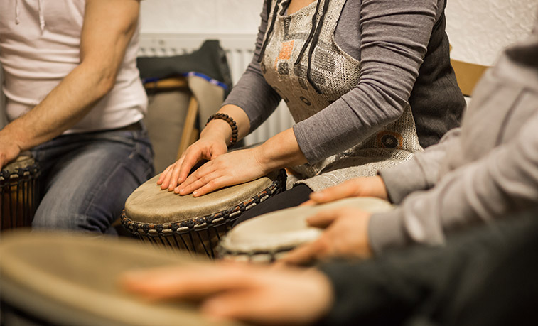 Music Therapists playing drums