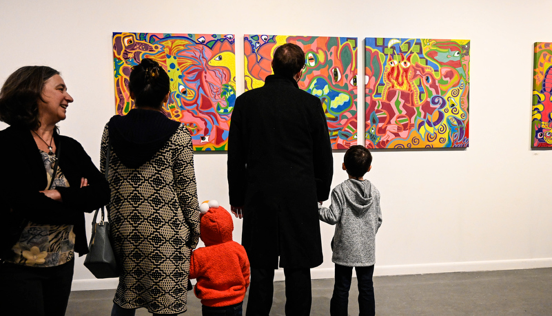 a family looking at art