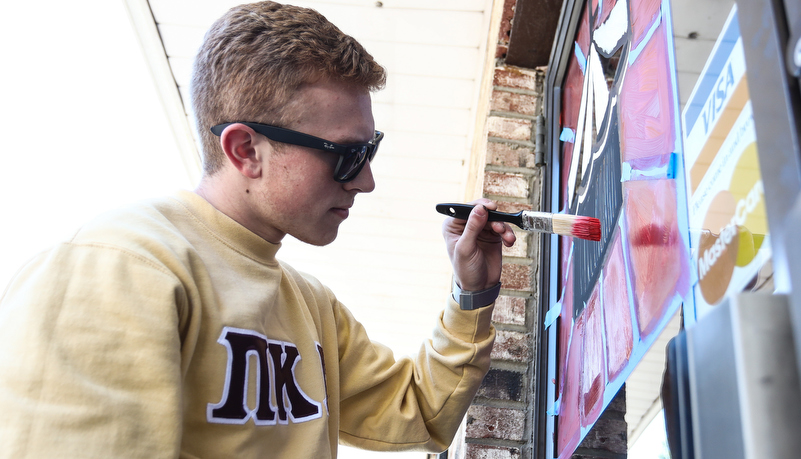 Student's painting indows on main street