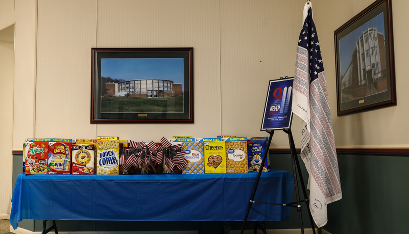 Donations on the table with a memorial to 9-11