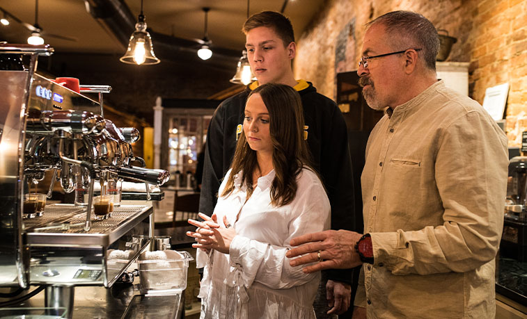 Students learn how to make espresso