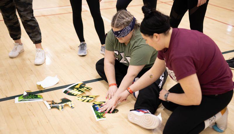 Blindfolded students playing a game