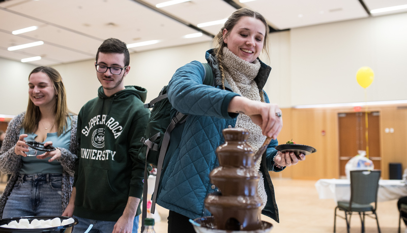 Students making treats in a chocolate fountain